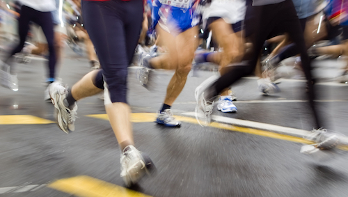 fast marathon runners slow sync close up shoot